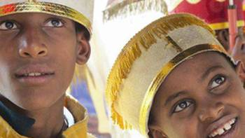 Young deacons preparing for the Ethiopian Orthodox Christian Timket Festival | Chris Buykx