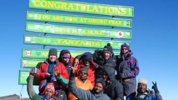 World Expeditions Kilimanjaro Summiteers,  Uhuru Peak, Tanzania | The Kilimanjaro Boomers