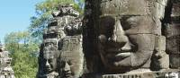 Some of the many stone faces carved into the Bayon Temple in the Angkor Wat complex | Donna Lawrence