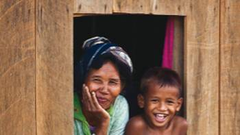 Relaxed Mother and Son onlooking the streets of Cambodia | Peter Walton