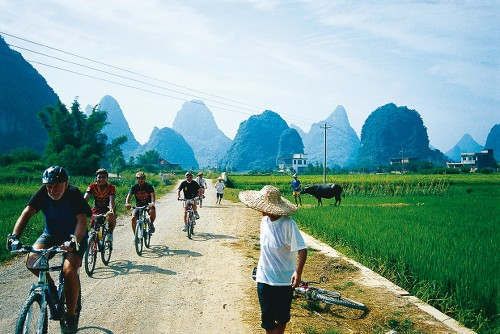 Cycling through rural villages Yangshao, China - <i>Photo: Scott Pinnegar</i>