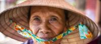 Local Vietnamese woman in her 'Non la' traditional hat | Richard I'Anson