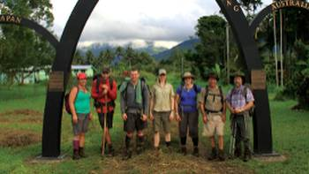 Trekkers at the end of the Kokoda Trail | Ken Harris