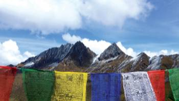 Prayer flags atop a pass in Bhutan | Gavin Turner