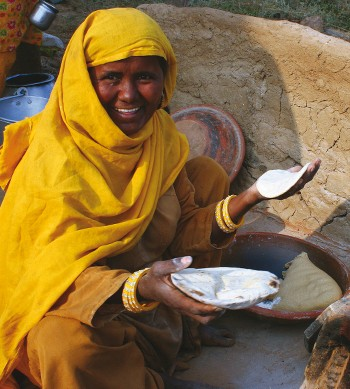 Local woman making chipati - <i>Photo: Keri May</i>