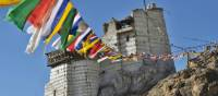 Prayer flags and ancient ruins in the the Indian Himalayan region | Adam Mussolum