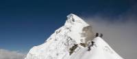 Climbers moving onto a subsidiary peak of Lobuche East, in the Khumbu region of the Himalaya