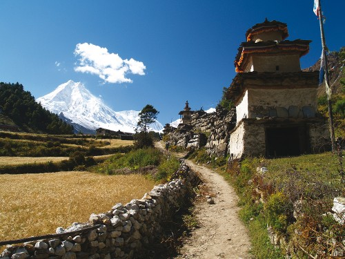 Trekking through peaceful villages in Manaslu - <i>Photo: Graham North</i>