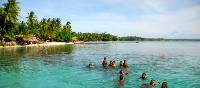 Children enjoying a swim in the waters of Melanesia | A Russ