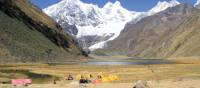 Camping amongst the rugged snowcapped peaks of Huayhuash, Peru | Ken Harris