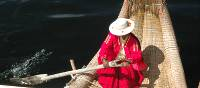 A lady of the Uros Islands, on Lake Titicaca in Peru. | Sarah Higgins