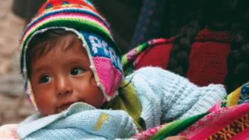 A young local rugs up in Cusco, Peru | Ian Williams