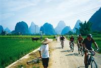 Cycling in rural villages in Yangshuo, China.