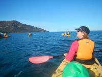 Kayaking in Coles Bay, Tasmania. Image credit: Brian Dodson
