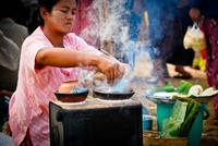 Local woman preparing street food.