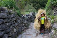 A little girl passes me on the trail to Nepal, I had to be quick with my camera to get this picture!