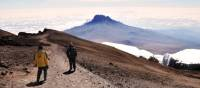 Trekkers descending Mount Kilimanjaro | Peter Brooke