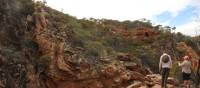 Admiring the rock formations near the Serpentine Chalet Damn Lookout along the Larapinta Trail | Larissa Duncombe