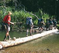 Trekkers crossing the Brown River on Day 5 of the Kokoda Trail -  Photo: Rachael Davis