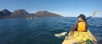 Kayaking on Coles Bay, with the Hazards in the distance | Brad Atwal