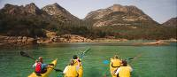 Kayaking the crystal clear waters of the Freycinet Peninsula on Cycle, Kayak and Walk Tasmania