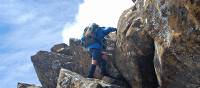The bushwalks of South West Tasmania often require scrambling over rocky crags | Chris Buykx