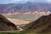 The road between Naryn and Bishkek winds its way through spectacular valleys |  <i>Peter Walton</i>