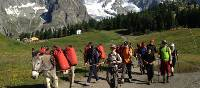 Families walking with donkeys beneath the lofty heights of Mont Blanc | Kate Baker