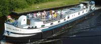 The Anna Maria V barge sailing the waterways on the Taste of Burgundy