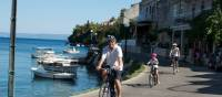 Cycling past boats on the Croatian islands with kids | Ross Baker