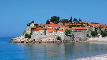 Cycle past small coastal village, like Budva, in Montenegro