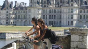 Cyclists at Chambord castle, Loire Valley