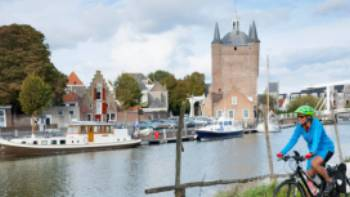 Cycling along the canal in Zierikzee in the province of Zeeland