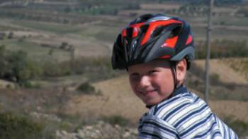 Child cycling through the countryside in Sardinia