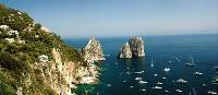 View of the Faraglioni rocks on the coastline of Capri, Italy | Sue Badyari