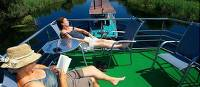 Relaxing on board the boat on the Danube Delta