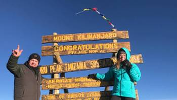 Celebrating on the summit of Mount Kilimanjaro | Georgia Canning