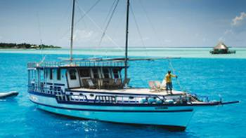 A traditional dhoni cruise is the best way to explore the turquoise waters of the Maldives