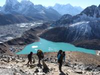 Trekkers descending Gokyo Ri with stunning views of Gokyo Lake |  <i>Ayla Rowe</i>