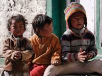 Happy Nepalese children relaxing in the streets |  <i>Charles Duncombe</i>