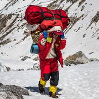 Local porter carrying gear along high passes in Nepal |  <i>Lachlan Gardiner</i>