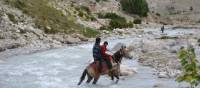 Local horseman and his son crossing Kali Gandaki river. | Chris Klep