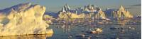 Midnight sun illuminates Icebergs near Ilulissat off the coast of Greenland