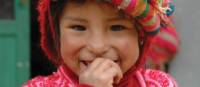 Big smiles from Quechua girl from Huilloc | Donna Lawrence