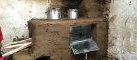 Part way through installing a new cook stove in a kitchen in Huilloc village, Peru | Dnona Lawrence