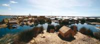 Traditional village in the Uros Islands | Nigel Leadbitter