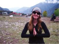 Happy trekker giving thanks for a great trip |  <i>Sally Imber</i>