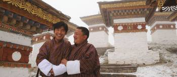 Two local Bhutanese men standing outside a temple | Liz Light