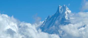 Machapuchare peaking through the clouds | Andrew Dixon / Bardo Imber-Dixon