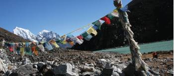 Prayer flags over Gokyo lake in Nepal's Sagarmatha National Park | Keri May